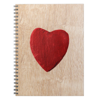 Wood background with heart notebook