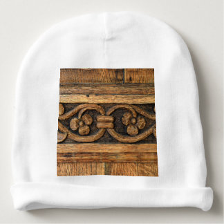 wood panel sculpture baby beanie