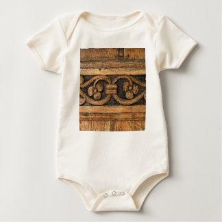wood panel sculpture baby bodysuit