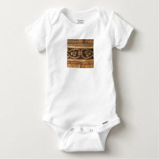 wood panel sculpture baby onesie