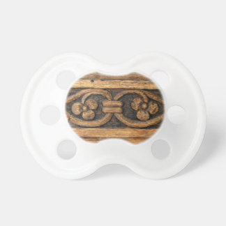 wood panel sculpture baby pacifier