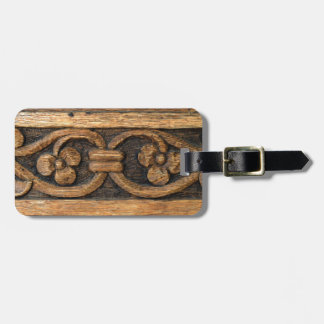 wood panel sculpture luggage tag