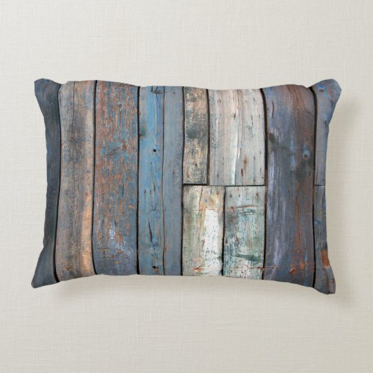 Wood slats of boards front grunge ailing old decorative pillow