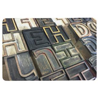 Wood type outline letters floor mat