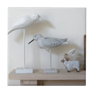 Wooden birds and birch sheep tile