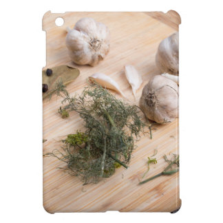 Wooden board with garlic and dried spices closeup case for the iPad mini