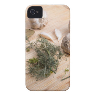 Wooden board with garlic and dried spices closeup Case-Mate iPhone 4 case
