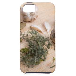 Wooden board with garlic and dried spices closeup iPhone 5 cases