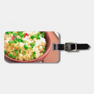Wooden bowl of cooked rice and leek bag tag