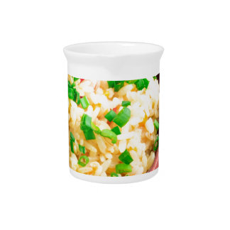 Wooden bowl of cooked rice and leek pitcher