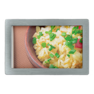 Wooden bowl of cooked rice and vegetables belt buckle