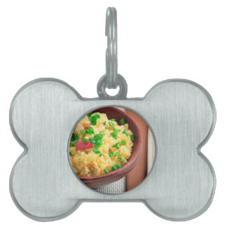 Wooden bowl of cooked rice and vegetables pet ID tag