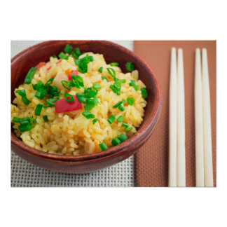 Wooden bowl of cooked rice and vegetables poster