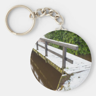Wooden bridge covered with snow in winter basic round button keychain