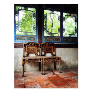 Wooden chairs and windows with carved patterns postcard