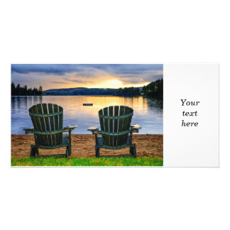Wooden chairs at sunset on beach photo card template