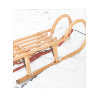 Wooden children sled in winter snow notepad