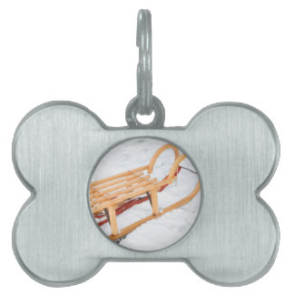 Wooden children sled in winter snow pet ID tag