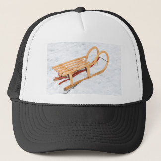 Wooden children sled in winter snow trucker hat