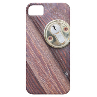 Wooden door with a keyhole brass iPhone 5 covers