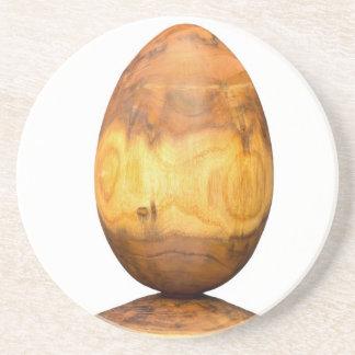Wooden egg made of acacia tree with bark. coasters