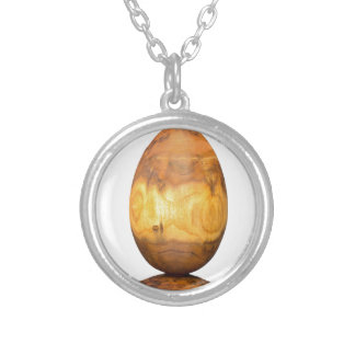 Wooden egg made of acacia tree with bark. silver plated necklace