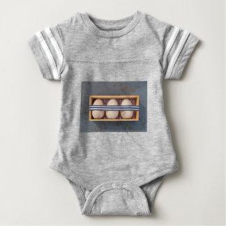 Wooden eggs in a box baby bodysuit
