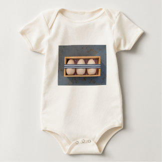 Wooden eggs in a box baby bodysuit