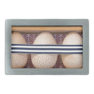 Wooden eggs in a box belt buckles