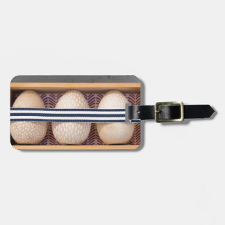 Wooden eggs in a box luggage tag