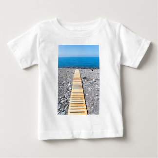 Wooden footpath on beach leading to portuguese sea baby T-Shirt