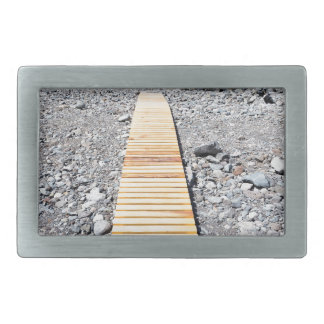 Wooden footpath on beach leading to portuguese sea belt buckle