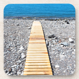 Wooden footpath on beach leading to portuguese sea coaster