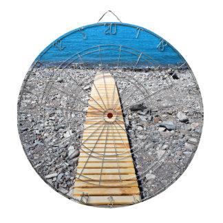 Wooden footpath on beach leading to portuguese sea dartboard