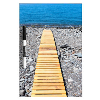 Wooden footpath on beach leading to portuguese sea dry erase board