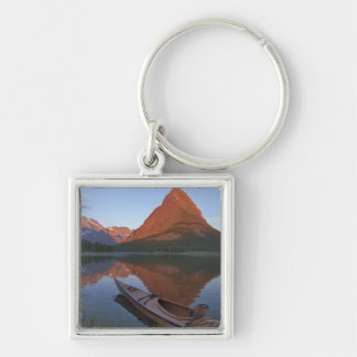 Wooden kayak in Swiftcurrent Lake at sunrise in Silver-Colored Square Keychain