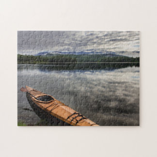 Wooden kayak on shore of Beaver Lake Jigsaw Puzzle
