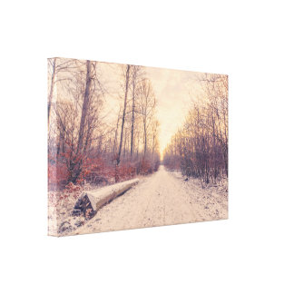 Wooden log by the road in the winter canvas print