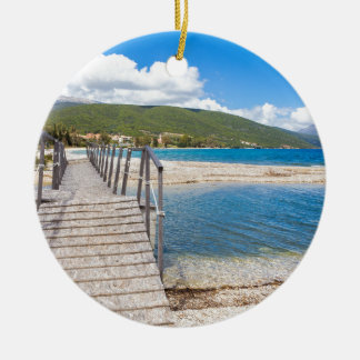 Wooden pedestrian bridge on greek beach ceramic ornament