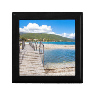 Wooden pedestrian bridge on greek beach gift box