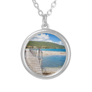 Wooden pedestrian bridge on greek beach silver plated necklace