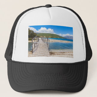 Wooden pedestrian bridge on greek beach trucker hat