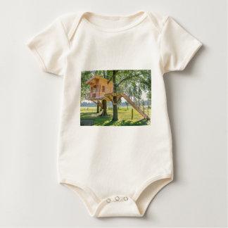 Wooden tree house in oak tree with grass baby bodysuit