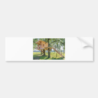 Wooden tree house in oak tree with grass bumper sticker
