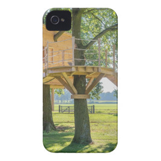 Wooden tree house in oak tree with grass iPhone 4 covers