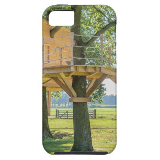 Wooden tree house in oak tree with grass iPhone 5 cases