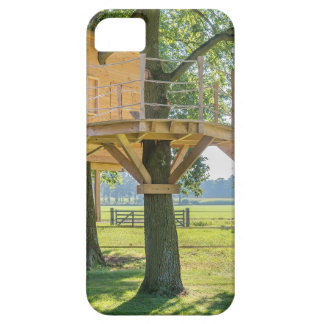 Wooden tree house in oak tree with grass iPhone 5 covers
