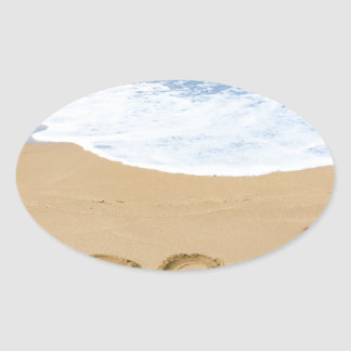 Word beach on sandy coast with blue sea oval sticker