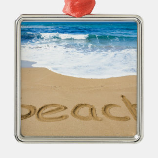 Word beach on sandy coast with blue sea Silver-Colored square ornament
