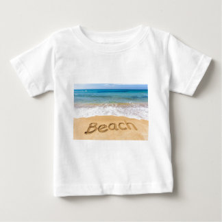 Word Beach written in sand at greek sea Baby T-Shirt